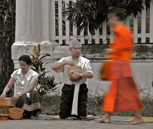 Observing the locals participate in the morning giving of Alms.